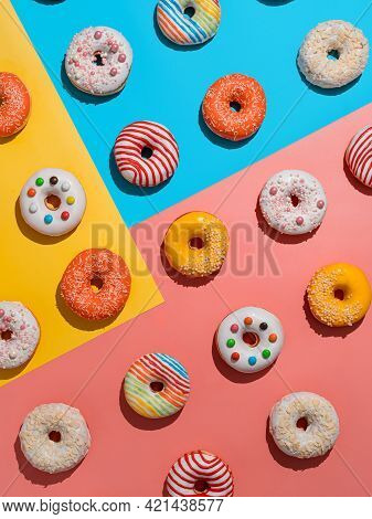 Assorted Colorful Glazed Donuts, Top View. Creative Layout Made From Delicious Glazed Donuts. Vertic