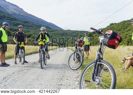 South Island New Zealand - March 5 2015; Group Middle-aged Cyclists Stop Along Rural Road For A Brea
