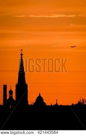 Conceptual Photo Of City Downtown At Sunset With Skyline Silhouette Against A Beautiful Orange Sky A
