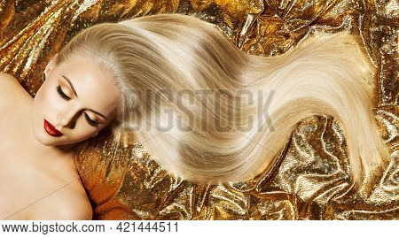 Beauty Blonde Hairstyle Model. Shiny Straight Long Golden Blond Hair Close Up. Glamour Luxury Woman