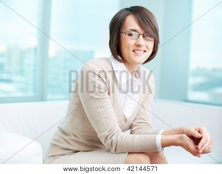 Portrait of a successful psychologist or a businesswoman looking at camera