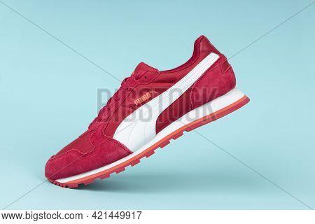 Varna , Bulgaria - April 22, 2021. Red Puma Sport Shoe On Blue Background. Puma, A Major German Mult