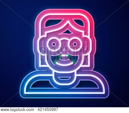 Glowing Neon Line Hacker Or Coder Icon Isolated On Blue Background. Programmer Developer Working On