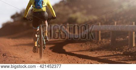 Mountain Biker Riding On Bike Singletrack Trail, Back View Of Mountain Biker. Mountain Bike Race