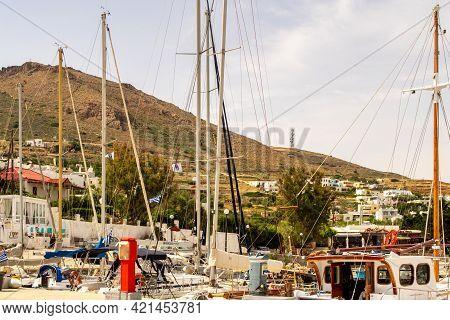 Finikas, Greece, 27.05.2019. Dock In Finikas Port On Siros Island, Greece, With Row Of Colorful Sail