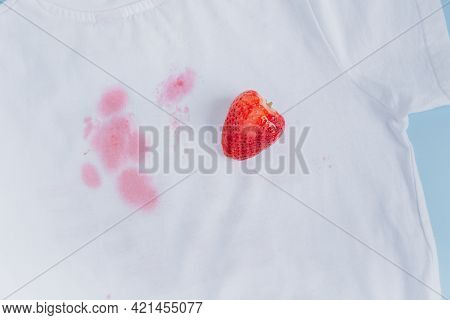 Close Up Of A Complex Berry Stain On White Clothes. Top View. High Quality Photo