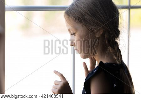 Depressed Orphan Kid Looking Out Window, Feeling Lonely