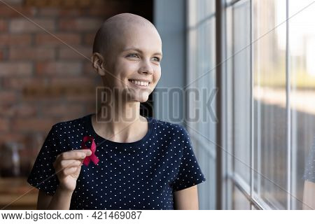Happy Hairless Girl With Oncology Disease Holding Red Ribbon