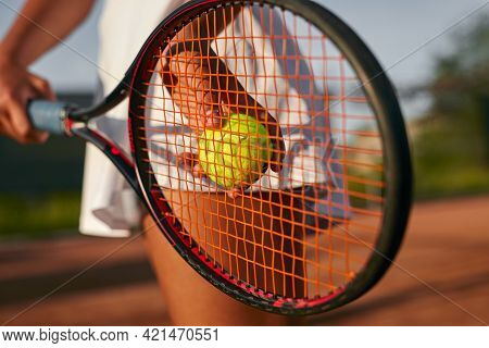 Soft Focus Of Anonymous Female Tennis Player Preparing To Toss Ball With Racket During Match On Cour