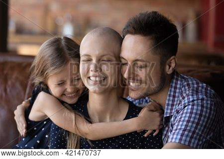 Happy Daughter Kid And Dad Hugging Ill Hairless Mom