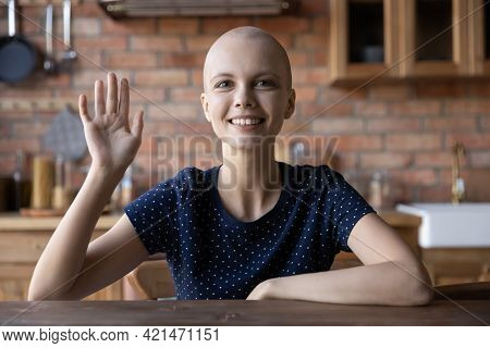 Happy Hairless Girl With Cancer Smiling, Looking And Waving Hand