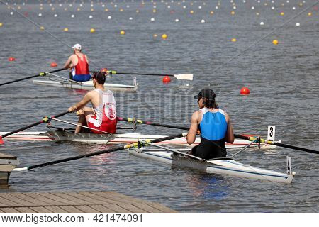 Moscow, Russia - May 2021: Guys Are Rowing In Boats. Athletes During The Competitions On The Rowing