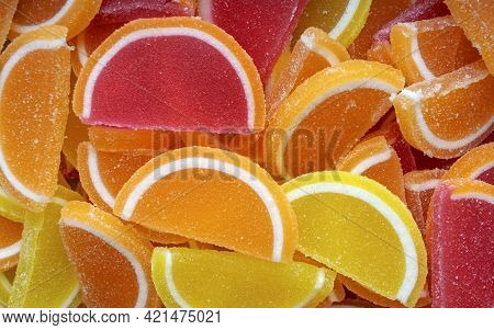 Colorful Oval Citrus Jelly Candies Pattern Background. Yellow, Pink, Red, Orange Round Shaped Marmal