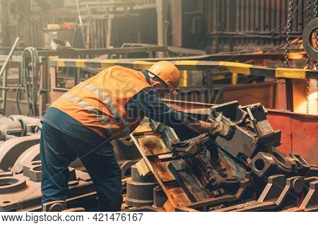 Metallurgical Plant Or Foundry Worker And Large Steel Product In Workshop.