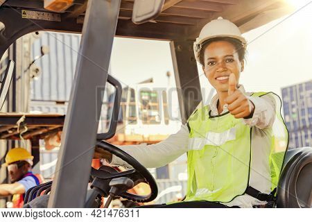 Portrait Female Worker Driving A Forklift Showing His Thumb Up : African American Female Foreman, Fo