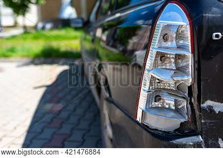 Broken Taillight On A Parking Car, Shallow Depth Of Field, Space For Text.
