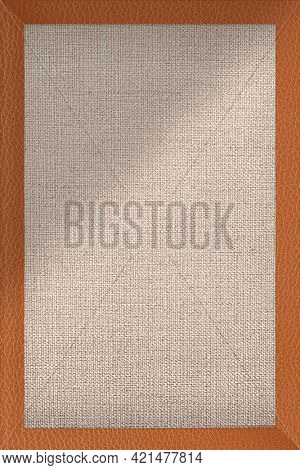Orangish brown leather frame on brown fabric textured bacgkround vector