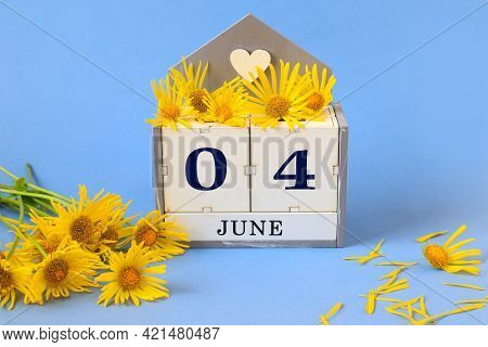 Calendar For June 4: Cubes With The Numbers 0 And 4 , The Name Of The Month Of June In English, Yell