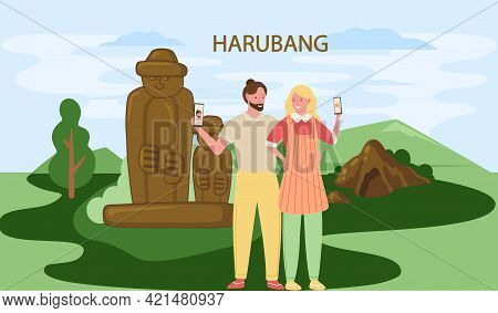 Tourists Take Photo Near Stone Sculptures And Tropical Plants In Stone Park. Statue Of Dol Hareubang
