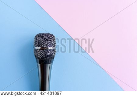 Microphone On A Colorful Pink And Blue Geometric Background Close Up. Singing, Writing Music, Karaok
