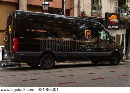 Palma De Mallorca, Spain; May 19 2021: Van Of The International Transport Company Ups Filling Up Wit