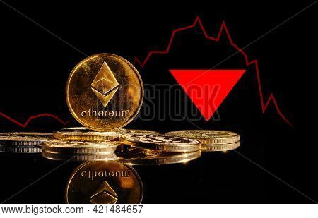 Crypto Collapse. Golden Coins With Ether Logo Drop At Bear Market. Pullback Of Cryptocurrency Ethere