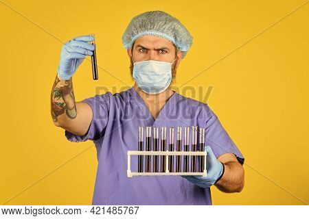 Critical Number Or Density Of Susceptible Hosts. Man In Medical Lab Inspecting Samples Biological Ma