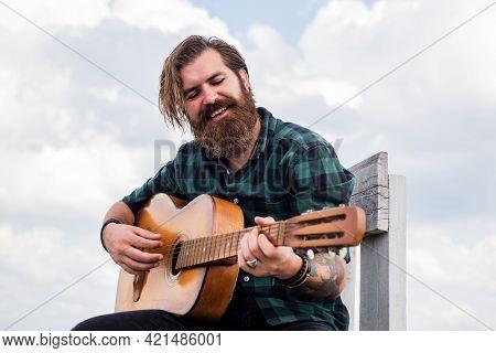 Mature Bearded Man Looking Casual Trendy Playing Guitar, Guitarist
