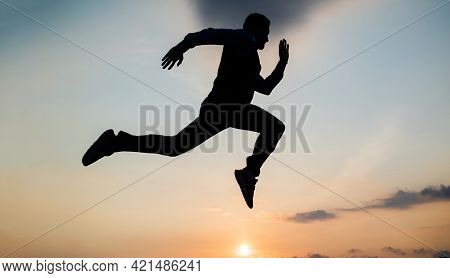 Freedom Is Not Enough. Personal Achievement Goal. Man Silhouette Jump On Sky Background. Confident B