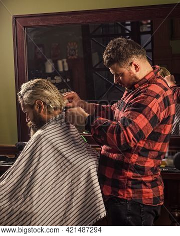 Man In Hair Salon With Hipster Haircut. Beard And Mustaches. Professional Hairstylist In Barbershop