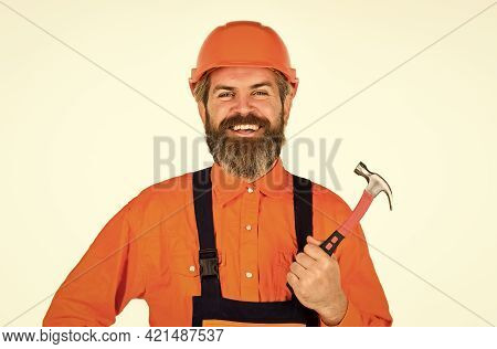 Technical Work. Bearded Mature Man In Uniform. Guy With Hammer. Good Hammer. Almost Every Household