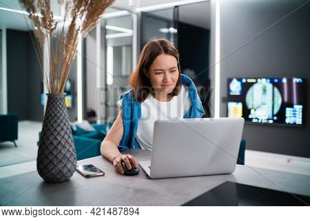 Female Gamer Playing Video Game From Home Using Laptop. Professional Player Testing Online Video Gam