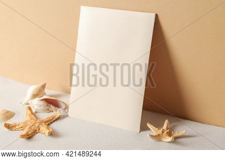 Scented Sachet, Starfishes And Sea Shells On Sand Near Orange Wall