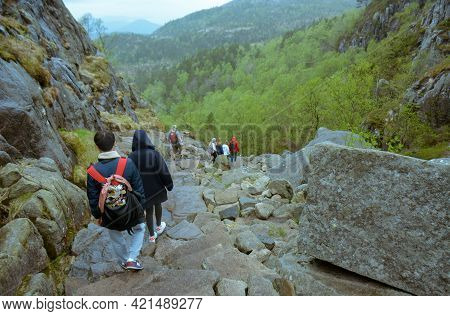 Rogaland, Norway - 23rd May, 2017: Visitors Heading Down The Treacherous Trail After Having Visited