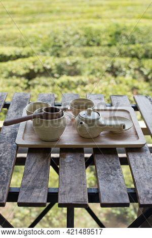 Ceramic Tea Set Herbal Tea, Fresh Green Tea Leaves Background.