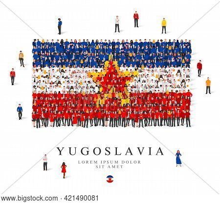 A Large Group Of People Are Standing In Blue, Yellow, White And Red Robes, Symbolizing The Flag Of Y