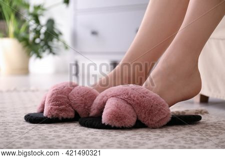 Woman In Fuzzy Slippers At Home, Closeup