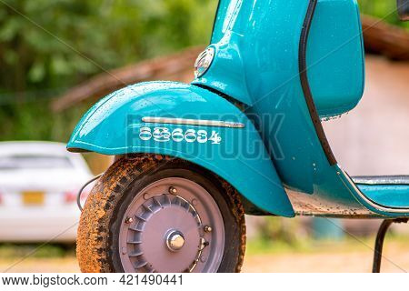 Galle, Sri Lanka - 06 21 2020: Vespa Scooter Front Wheel Close Up View, Parked In A Muddy Road In A
