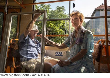 Budapest, Hungary - August 11, 2017: Old People, Lovers, Senior Couple, Sitting In A Tram Of The Bud