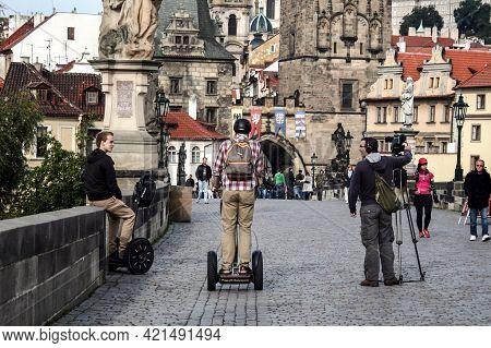Prague, Czechia - September 21, 2012: Men, Tourists, Riding Segways On Cobblestone Street On Karluv