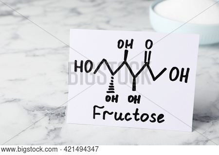 Paper With Word Fructose And Drawn Scheme On White Marble Table