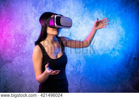 Young Teen Gamer Wearing Vr Glasses Standing And Playing Virtual Reality Game