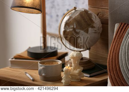 Beautiful David Bust Candles And Cup Of Hot Drink On Table Indoors, Space For Text