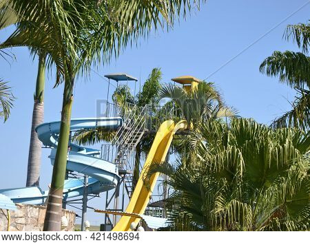 Water Park. Water Park With Colorful Water Tube Among Trees And Blue Sky In Summer At Ecotourism Far