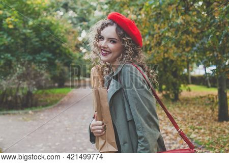 Happy Young Woman In Red Beret Laughing Outdoor