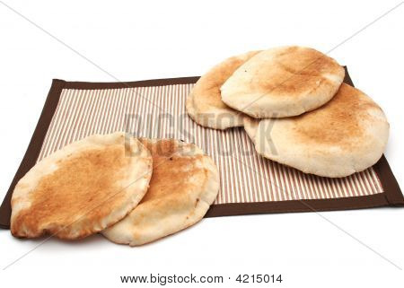 Baked Arabic Bread on Brown Table Cover poster