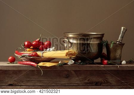 Pasta With Ingredients On A Old Wooden Table. Brown Bacground With Copy Space.