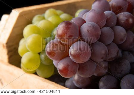 Grapes, Wooden Box With Grapes In Closeup, Black Background, Selective Focus.
