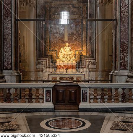 Vatican - June 1, 2020: La Pieta sculpture by Michelangelo Buonarroti, inside St. Peter's Basilica in Vatican, Rome, Italy