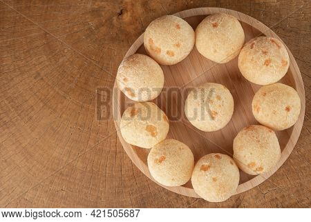 Brazilian Cheese Bread, Cheese Breads Arranged On Wooden Plate, On Rustic Wood, Top View.